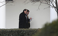 David Axelrod, Senior White House Advisor, walks with an unknown person taking notes, near the Rose Garden.  Photograph by Dennis Brack