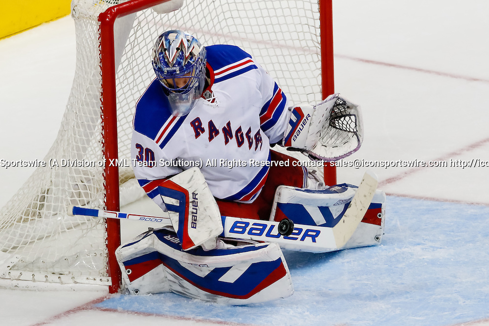 29 DEC 2014: New York Rangers Goalie Henrik Lundqvist (30) [2585] makes a stick save during the NHL game between the New York Rangers and the Dallas Stars at the American Airlines Center in Dallas, TX.  Dallas defeats New York 3-2.