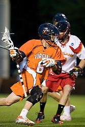 Virginia attackman Ben Rubeor (6) is defended by Maryland midfielder Zach Hinton (7).  The #3 ranked Virginia Cavaliers defeated the #8 ranked Maryland Terrapins 11-8 in the semi finals of the Men's 2008 Atlantic Coast Conference tournament at the University of Virginia's Klockner Stadium in Charlottesville, VA on April 25, 2008.