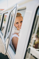 Bride Liana waits in the Kombi van before her wedding in Point Piper, Sydney, Australia. <br />