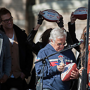 05 November 2012:  NE Patriots owner Robert Kraft signs and presents Aerosmith's Steven Tyler with a custom game ball before Aerosmiths' free concert  in Allston.  Guitar player Joe Perry and bass player Tom Hamilton raise up theirs  as thousands of fans filled Commonwealth Avenue to watch Aerosmith play in front of the building (No. 1325) where band members once lived.  Boston, MA. ***Editorial Use Only*****