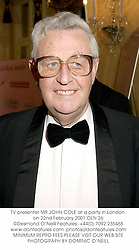 TV presenter MR JOHN COLE at a party in London on 22nd February 2001.OLN 26