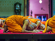 "04 MARCH 2015 - BANGKOK, THAILAND: Buddhist monks pray in the ""wiharn,"" or prayer hall at Wat Benchamabophit on Makha Bucha Day. Makha Bucha Day is an important Buddhist holy day and public holiday in Thailand, Cambodia, Laos, and Myanmar. Many people go to temples to perform merit-making activities on Makha Bucha Day. Wat Benchamabophit is one of the most popular Buddhist temples in Bangkok.    PHOTO BY JACK KURTZ"
