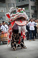 Lion dance at a temple festival in old Liwan district of Guangzhou.
