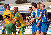 Photo: Ashley Pickering.<br />Colchester United v Norwich City. Coca Cola Championship. 31/03/2007.<br /><br />Chris Martin of Norwich (L) is restrained by team mate Dion Dublin as he clashes with some of the Colchester players