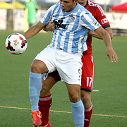 Wilmington Hammerheads FC's Samuel Ochoa challenges Toronto FC's Nick Hagglund Wednesday June 18, 2014 at Legion Stadium in Wilmington, N.C. (Jason A. Frizzelle)