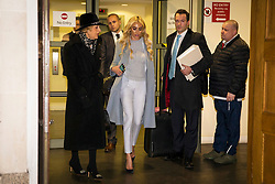 © Licensed to London News Pictures. 11/01/2018. London, UK. Petra Ecclestone (centre) leaves the High Court after a hearing over her legal battle with ex-husband James Stunt following their £5.5billion divorce. Photo credit: Rob Pinney/LNP