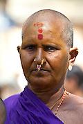 Hindu pilgrim with bindi mark at Vishwanatha Temple (Birla Temple) during Festival of Shivaratri in holy city of Varanasi, India