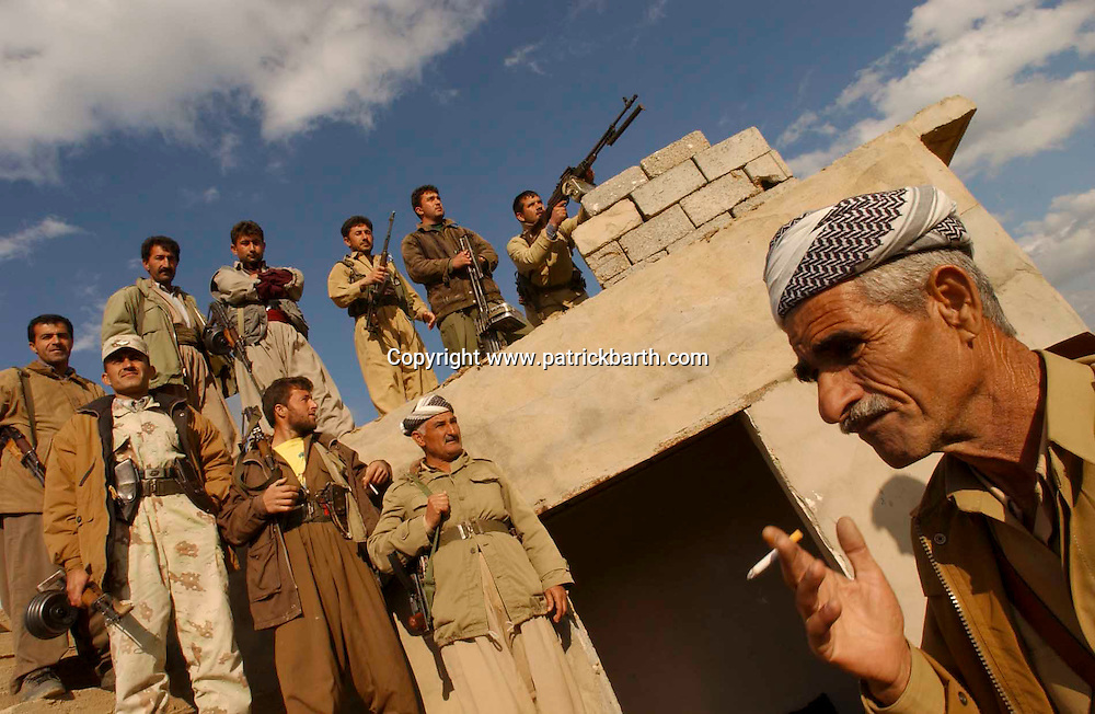 ERBIL, NORTHERN IRAQ - MARCH 21:  Kurdish Peshmerga Fighters are waiting for an imminent attack by the Iraqi army at the last frontline before Kirkuk near Pir Daud.<br /> They are overlooking the positions of the Iraqi army.    (Photo Patrick Barth/Getty Images)
