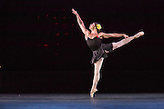 A well-muscled male dancer en pointe in a female role in Les Ballets Trockadero de Monte Carlo.