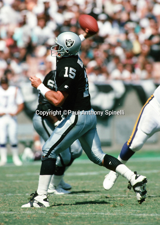 Los Angeles Raiders quarterback Jeff Hostetler (15) throws a pass during the NFL football game against the Minnesota Vikings on Sept. 5, 1993 in Los Angeles. The Raiders won the game 24-7. (©Paul Anthony Spinelli)