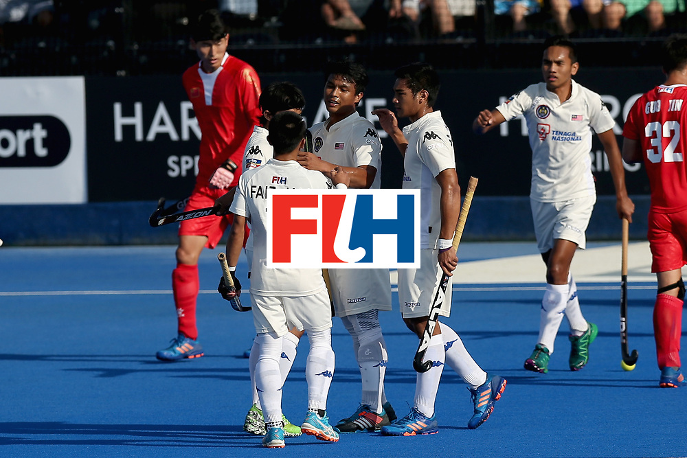 LONDON, ENGLAND - JUNE 20: Najmi Jazlan of Malaysia celebrates scoring his sides second goal with his Malaysia team mates during the Pool A match between China and Malaysia on day six of the Hero Hockey World League Semi-Final at Lee Valley Hockey and Tennis Centre on June 20, 2017 in London, England.  (Photo by Alex Morton/Getty Images)