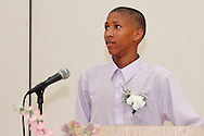 Keivon Greene leads the Pledge of Allegiance during the 8th grade recognition ceremony at Cleveland PK-8 School in Dayton, May 25, 2012.
