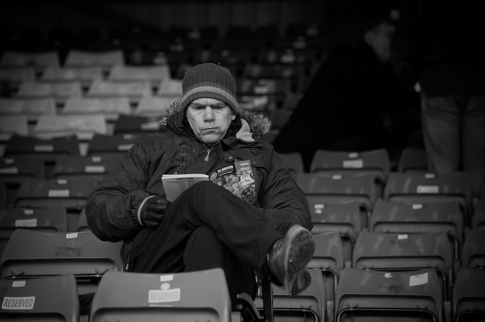 FC United of Manchester play a local team Chorley at Bury football club's ground in Lancashire, Britain. Photo shows FC United of Manchester supporter before the match.