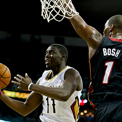 Oct 23, 2013; New Orleans, LA, USA; New Orleans Pelicans point guard Jrue Holiday (11) shoots over Miami Heat power forward Chris Bosh (1) during the first quarter of a preseason game at New Orleans Arena. Mandatory Credit: Derick E. Hingle-USA TODAY Sports
