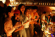 Chinese clubbers dancing in bar during golden week holiday