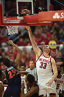 Wolfpack forward Wyatt Walker (33) tips in a rebound during ACC action against UVA.