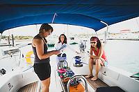 Elizabeth White goes over the charter ship checklist onboard the Grand Illusion, a Navtours ship. Grand Isle Marina, the Exumas, Bahamas.