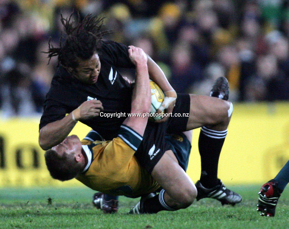 Tana Umaga crushes Drew Mitchell during the Bledisloe Cup match between the All Blacks and the Wallabies at Telstra Stadium, Sydney, Australia on Saturday 13 August, 2005. The All Blacks won the match 30 - 13. Photo: Hannah Johnston/PHOTOSPORT<br />