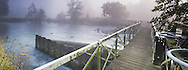 Sulhampstead weir and footbridge over the River Kennet near Reading, Berkshire, Uk