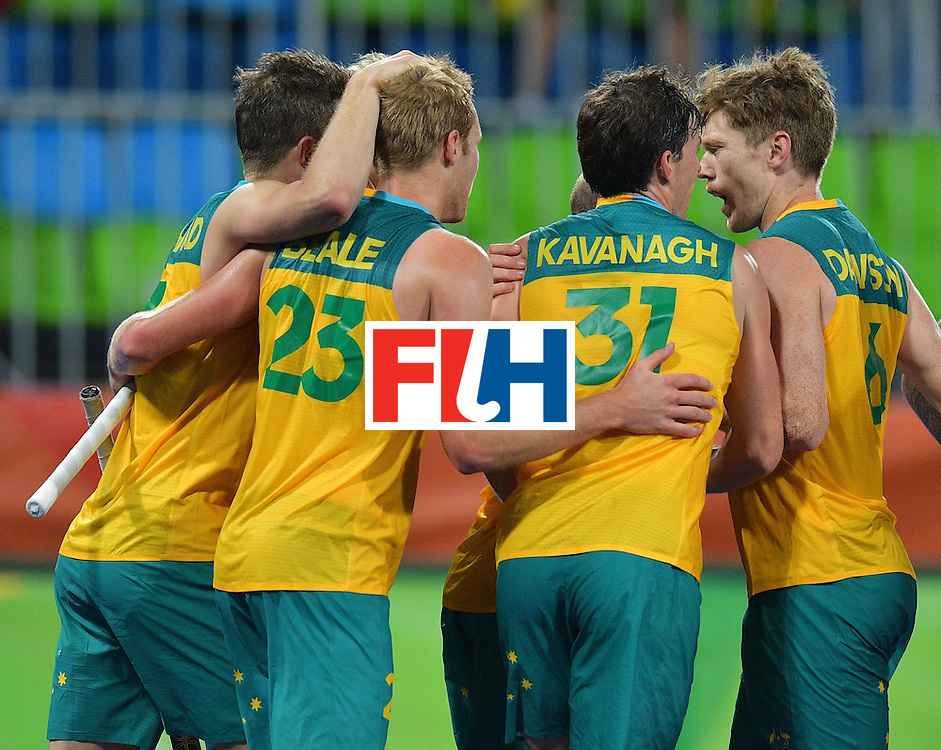 Australia players celebrate a goal during the men's field hockey Britain vs Australia match of the Rio 2016 Olympics Games at the Olympic Hockey Centre in Rio de Janeiro on August, 10 2016. / AFP / Carl DE SOUZA        (Photo credit should read CARL DE SOUZA/AFP/Getty Images)