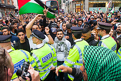 Kesnington, London, July 11th 2014. Thousands of Palestinians and their supporters block Kensington High Street as they demonstrate against the latest wave of Israeli retaliatory attacks on Palestinian targets and homes, where casualties are steadily mounting.