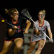23 March 2018: San Diego State Aztecs midfielder Elizabeth Rourke brings the ball around the back of the net in the second half. The Aztecs beat the Lady Flames 11-10 Friday night. <br /> More game action at sdsuaztecphotos.com
