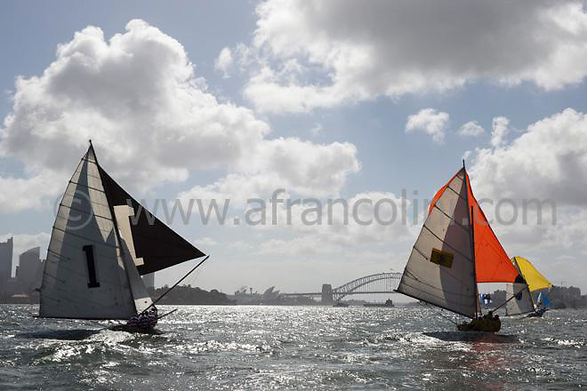 Classic yacht TOP WEIGHT (left) and SCOT during a spinnaker run with the Sydney Harbour bridge as a back drop on day 1 of the Historic 18ft Skiff Australian Championship on Sydney Harbour.  22/01/2015 (Photo: Andrea Francolini).