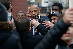 Former France international Thierry Henry is mobbed by fans taking 'selfies' as he arrives at Stamford Bridge in his role as a television pundit - Photo mandatory by-line: Rogan Thomson/JMP - 07966 386802 - 11/03/2015 - SPORT - FOOTBALL - London, England - Stamford Bridge - Chelsea v Paris Saint-Germain - UEFA Champions League Round of 16 Second Leg.