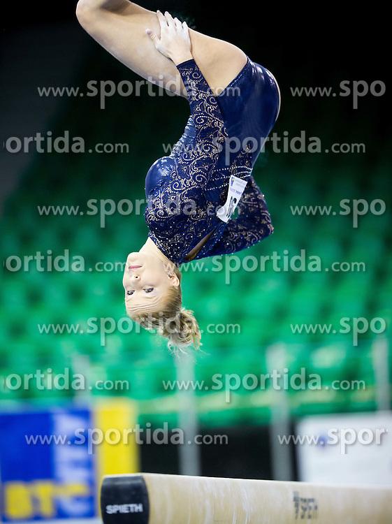 Adela Sajn of Slovenia competes in the Balance Beam during Qualifiying day  of Artistic Gymnastics World Challenge Cup Ljubljana, on April 18, 2014 in Hala Tivoli, Ljubljana, Slovenia. Photo by Vid Ponikvar / Sportida