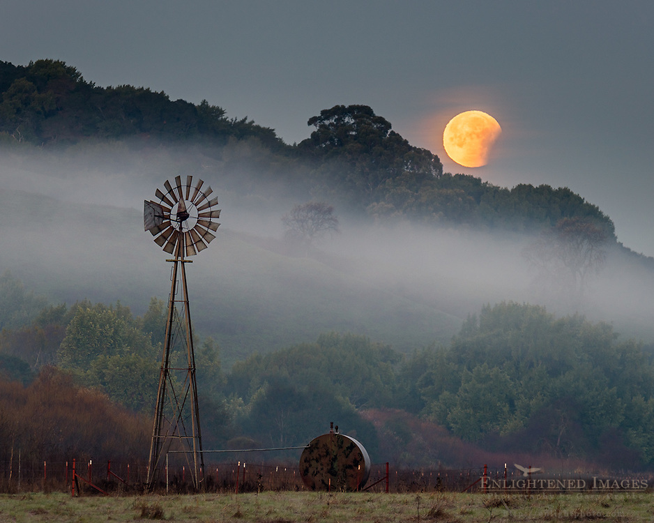 Super Blood Moon Lunar Eclipse sets next to windmill while coming out of totality in a rare 150-year convergence, Contra Costa County, California