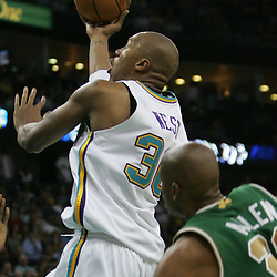 Hornets forward David West #30 shoots over Celtics guard Ray Allen #20 in the fourth quarter of their NBA game on March 22, 2008 at the New Orleans Arena in New Orleans, Louisiana. The New Orleans Hornets defeated the Boston Celtics 113-106.