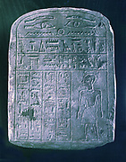 Votive stele dedicated by his brother to a man from Ermant, near Thebes.  Bas relief  carving with eye of Horus at top and various hieroglyphs.