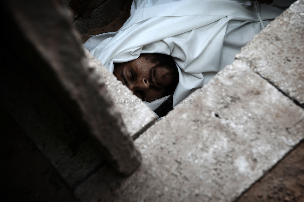 Photo of the body of Anwar al-Dreim, 24, taken during his funeral in the town of Beni Suheila in the southern Gaza Strip on January 27, 2009. Dreim was killed by Israeli fire in Gaza, medics said, shortly after Arab television reported that an Israeli soldier was killed in a blast near the border of the Hamas-run enclave.