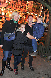 MATTHEW FREUD and ELISABETH MURDOCH and their children Charlotte and Samson at the opening of the 2012 Winter Wonderland, Hyde Park on 22nd November 2012.