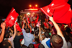 Fans of Turkey stopped the bus of their National basketball team and celebrate at the highroad after winning the second semifinal basketball match between National teams of Serbia and Turkey at 2010 FIBA World Championships on September 11, 2010 at the Sinan Erdem Dome in Istanbul, Turkey. Turkey defeated Serbia 83 - 82 and qualified to finals.  (Photo By Vid Ponikvar / Sportida.com)