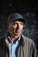 """NAPOLI, ITALY - 8 OCTOBER 2016: Pietro Ioia (57), activist and president of the association Ex D.O.N. (ex detenuti organizzati napoletani - organized ex Napoletan prisoners) and former drug trafficker for the Camorra, poses for a portrait in Napoli, Italy, on October 8th 2016. Pietro Ioia was a drug trafficker for the Camorra, the Italian Mafia-type crime organization which arose in the region of Campania and its capital Naples. For his crimes, he spent 22 years in prison. After being released, Mr. Ioia founded the association Ex D.O.N. (ex detenuti organizzati napoletani - organized ex Napoletan prisoners) which focuses on prisoners' rehabilitation in society after being released. Pietro Ioia also denounces prison guards abuses withing the Naples prison of Poggioreale. He publicly denounced the existence of the """"Cella Zero"""" (Cell Zero), an unnumbered cell inside the prison of Poggioreale, Naples, where prisoners were illegally beaten by prison guards."""