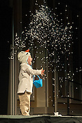 """Paxton Peterson, son of Dr. Brittany Peterson, assistant professor in the School of Communication Studies, throws fake snow during the talent portion of the Ava Nichols Faculty Pageant in Baker Ballroom on Wednesday, February 25. Paxton helped his mother perform """"Let It Go""""."""