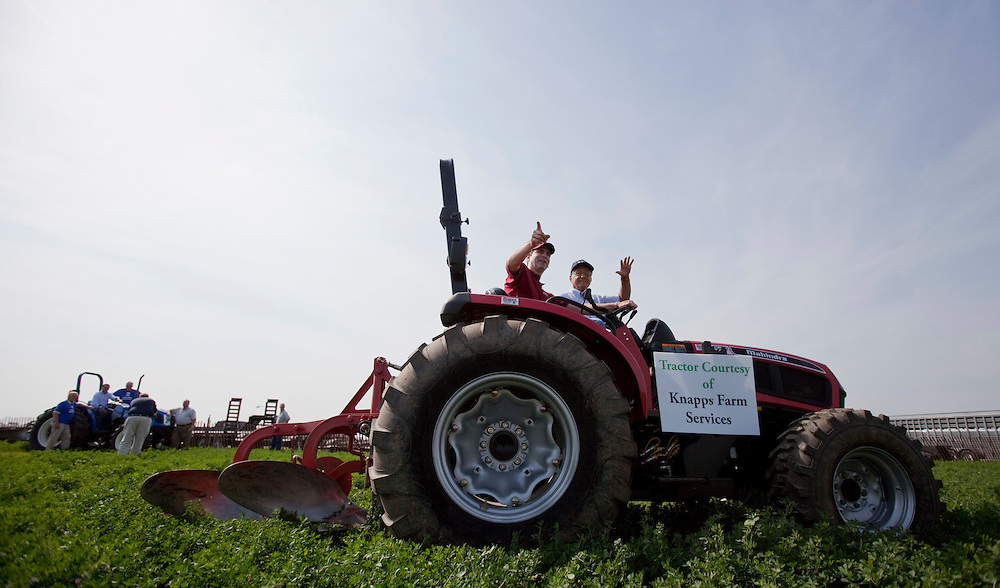 St.Thomas, Ontario ---10-09-21--- Ontario Premier Dalton McGuinty and local farmer George Beaudry wave as they prepare to plow a field at the 2010 International plowing match in St. Thomas, Ontario, Tuesday, September 21, 2010.<br /> GEOFF ROBINS The Globe and Mail