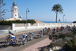 The peloton speed by Cullera Lighthouse at Setmana Ciclista Valenciana 2019 - Stage 1, a 126 km road race from Cullera to Gandia, Spain on February 21, 2019. Photo by Sean Robinson/velofocus.com