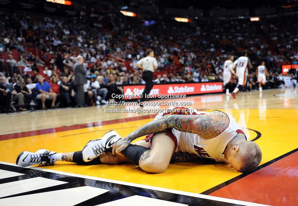 Nov. 23, 2014 - Miami, FL, USA - Miami Heat's Chris Andersen stays on the floor after what appeared to be an injury to his right leg during the first quarter on Sunday, Nov. 23, 2014, at AmericanAirlines Arena in Miami.
