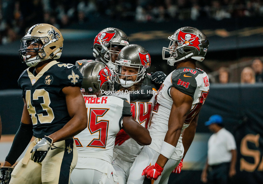 Sep 9, 2018; New Orleans, LA, USA; Tampa Bay Buccaneers quarterback Ryan Fitzpatrick (14) celebrates with teammates  after scoring against the New Orleans Saints during the first quarter of a game at the Mercedes-Benz Superdome. Mandatory Credit: Derick E. Hingle-USA TODAY Sports