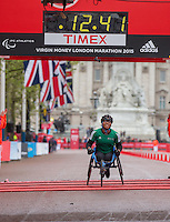 Shelby Watson crosses the line to win the Girls U17 Wheelchair Race in the Virgin Giving Mini London Marathon, Sunday 26th April 2015.<br /> <br /> Scott Heavey for Virgin Money London Marathon<br /> <br /> For more information please contact Penny Dain at pennyd@london-marathon.co.uk