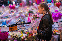 May 29, 2017 - Manchester, Greater Manchester, UK - Manchester , UK . Mourners pay their respects ahead of a vigil at 10:31pm in St Ann's Square in Manchester City Centre , exactly a week after Salman Abedi murdered 22 and injured another 64 at an Ariana Grande concert at Manchester Arena  (Credit Image: © Joel Goodman/London News Pictures via ZUMA Wire)