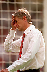 FILE PHOTO: Arsene Wenger is to leave Arsenal at the end of the season, ending a near 22-year reign as manager<br /><br />Arsenal manager Arsene Wenger walks out at Wembley for the second half with a headache ... Soccer - One 2 One FA Charity Shield - Manchester United v Arsenal ... 01-08-1999 ...   ...   ... Photo credit should read: Neal Simpson/EMPICS Sport. Unique Reference No. 322995 ... SOCCER<br />MAN UTD'S STEVE BRUCE <br />APPLAUDS AND <br />CELEBRATES HIS TEAMS <br />WIN.