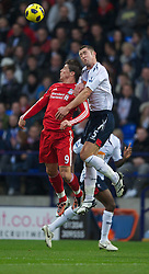 BOLTON, ENGLAND - Sunday, October 31, 2010: Liverpool's Fernando Torres and Bolton Wanderers' Gary Cahill during the Premiership match at the Reebok Stadium. (Pic by: David Rawcliffe/Propaganda)