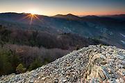 Above an endless mountain ridge at sunset