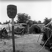 Carved wooden mask attached to a wooden pole.Glastonbury,Somerset, 1989.