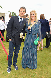 BEAR GRYLLS and his wife SHARA at the Cartier Queen's Cup Polo final at Guard's Polo Club, Smiths Lawn, Windsor Great Park, Egham, Surrey on 14th June 2015