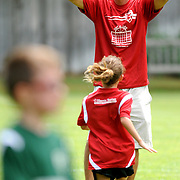 Coach Steven Pasquantonio waits to congratulate Syriana Pasquantonio, 8, after she scored during a Port City Soccer match Saturday September 6, 2014 at Olsen Farm Fields. (Jason A. Frizzelle)